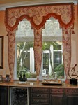 Upholstered Lambrequins over Roman Shades